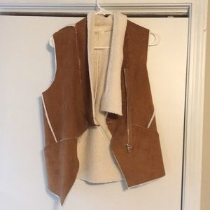 Tan vest, worn little and in good shape